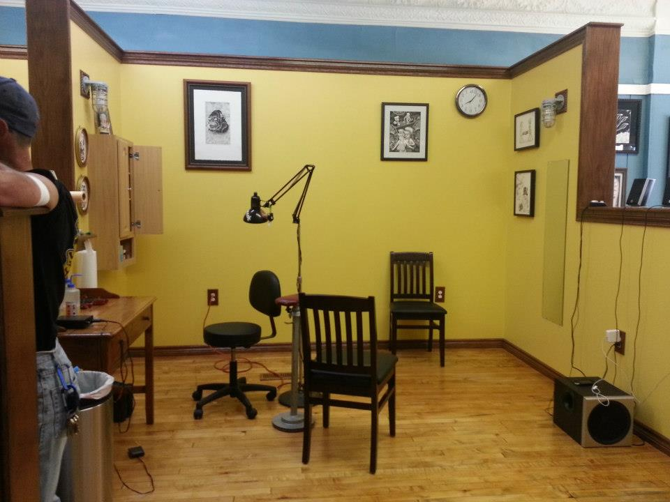 Village tattoo parlor shop in downtown romeo michigan village village tattoo romeo shop interior 11 malvernweather Choice Image